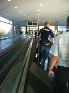 Darren Woollard and Curtis Brown, fellow Xtravirt colleagues walk the travellator