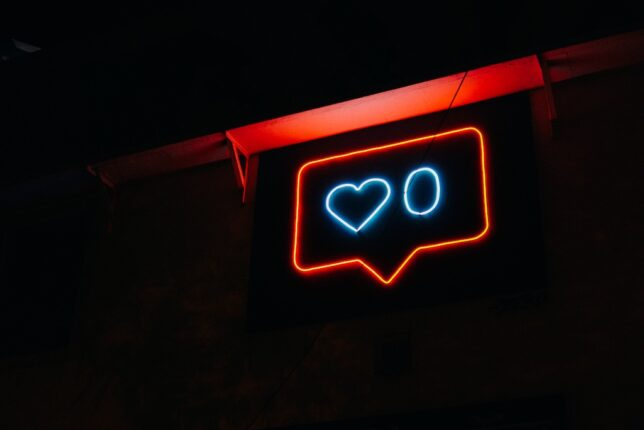 heart neon symbol with number zero next to it.