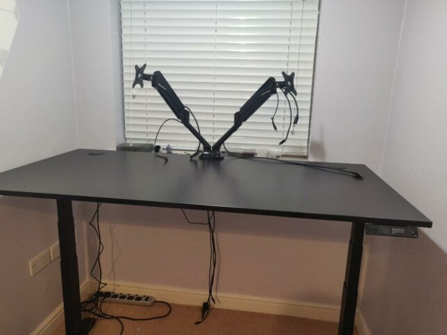 the monitor dual mount setup on the desk